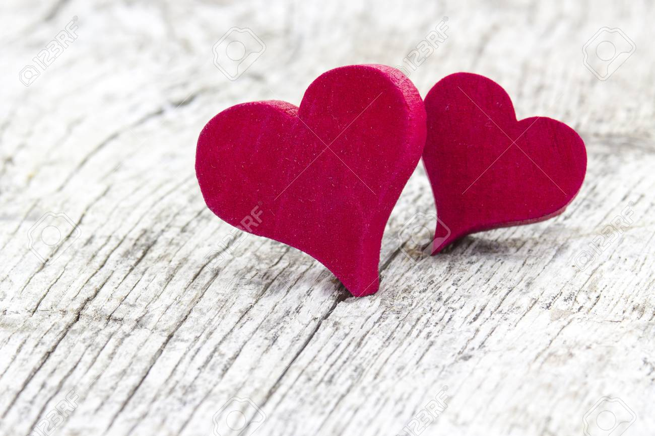 two red hearts on wooden background Stock Photo - 17333547