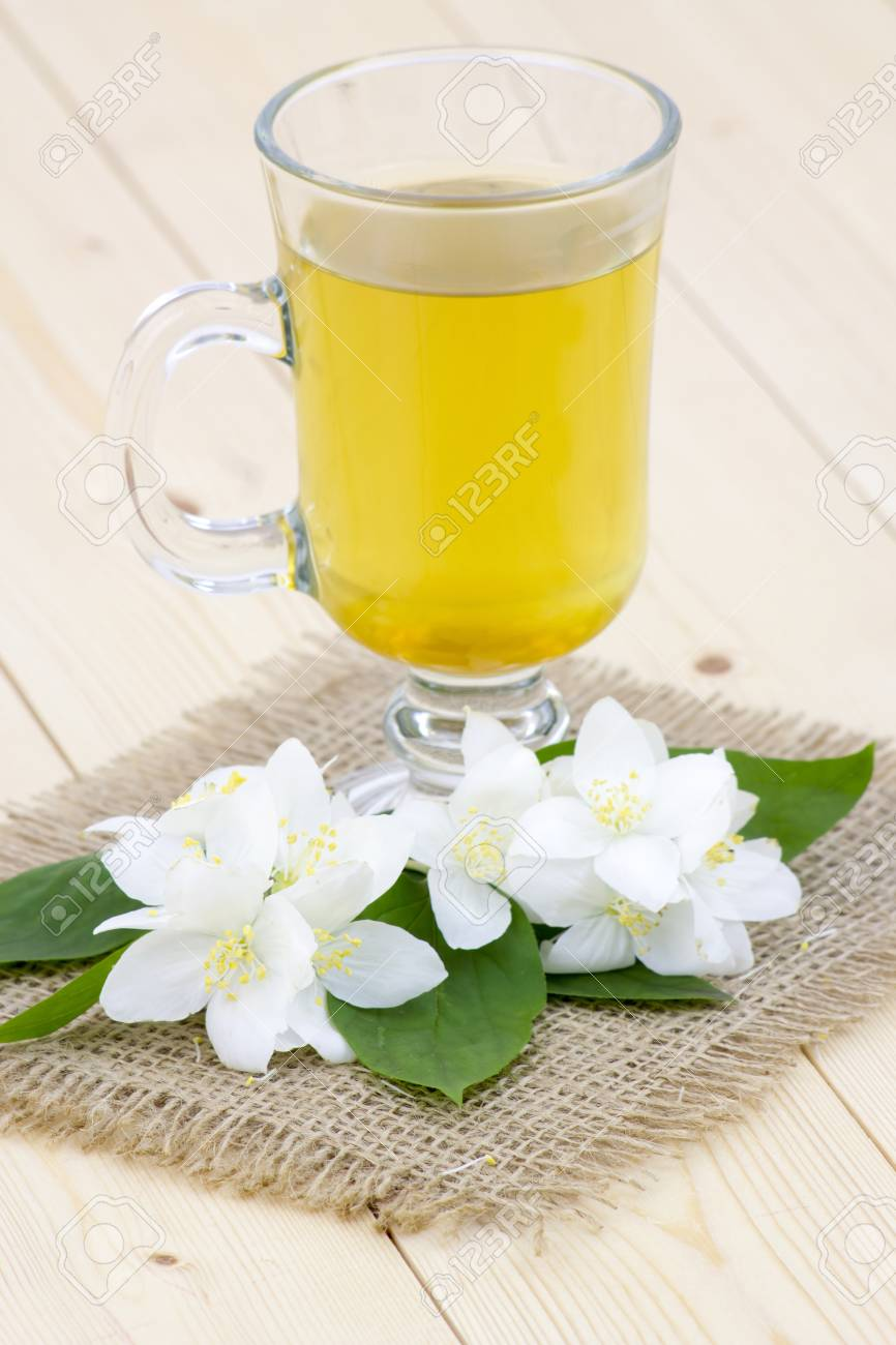 Glass Of Jasmine Tea And Jasmine Flowers Stock Photo Picture And