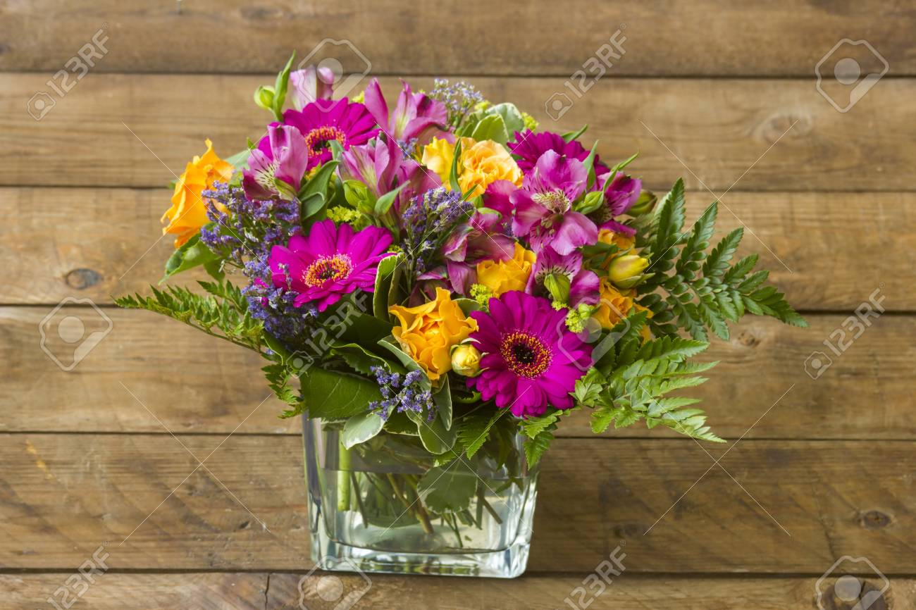 colorful flowers in a vase - 114258788
