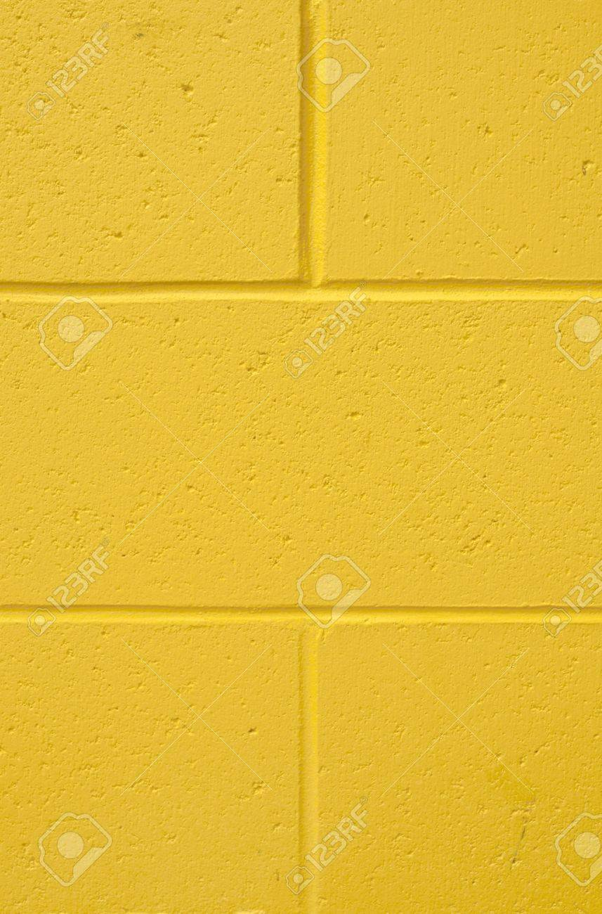 Painted cinder block wall texture - Vertical Background Shot Of A Painted Ywllow Cement Block Wall Stock Photo 6855113
