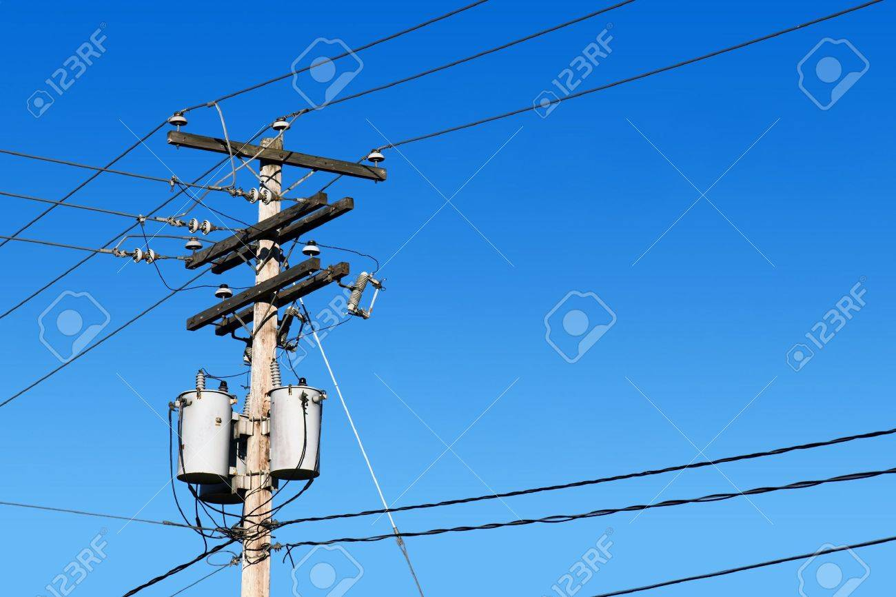 energy and technology electrical post by the road with power line