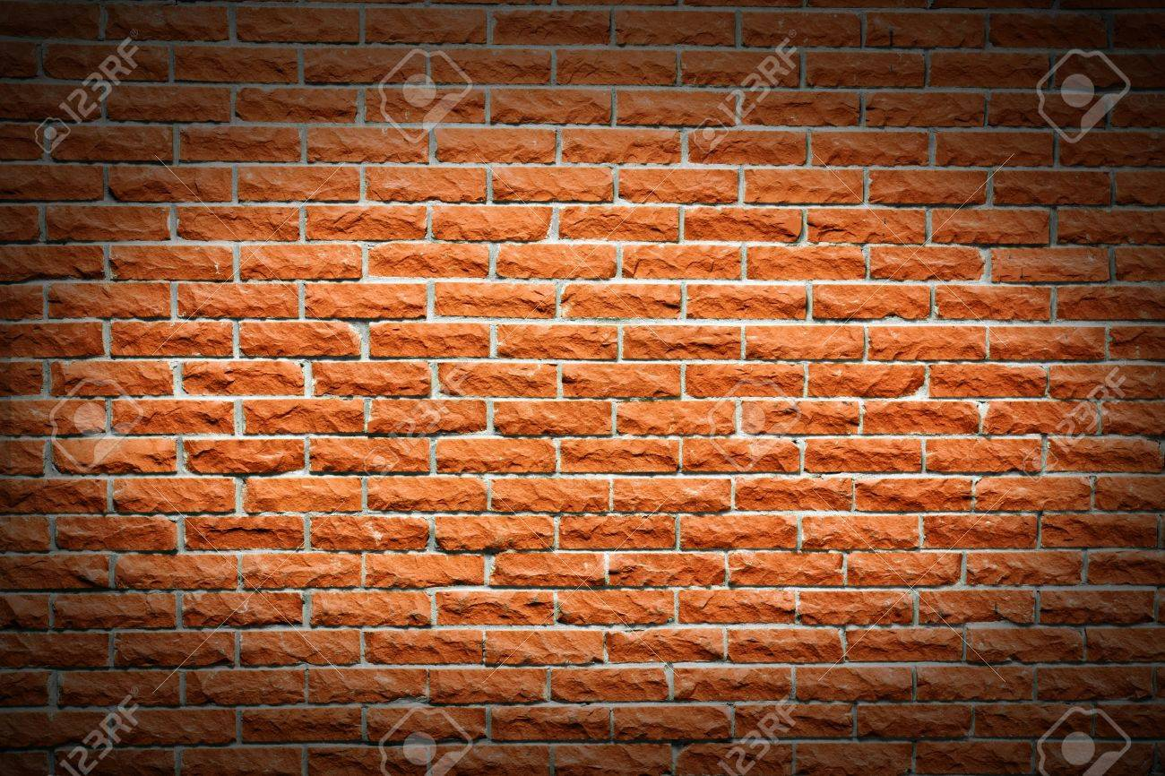 Another great brick wall background, orange terra cotta color, with follow spot highlight making a frame. Stock Photo - 9498457
