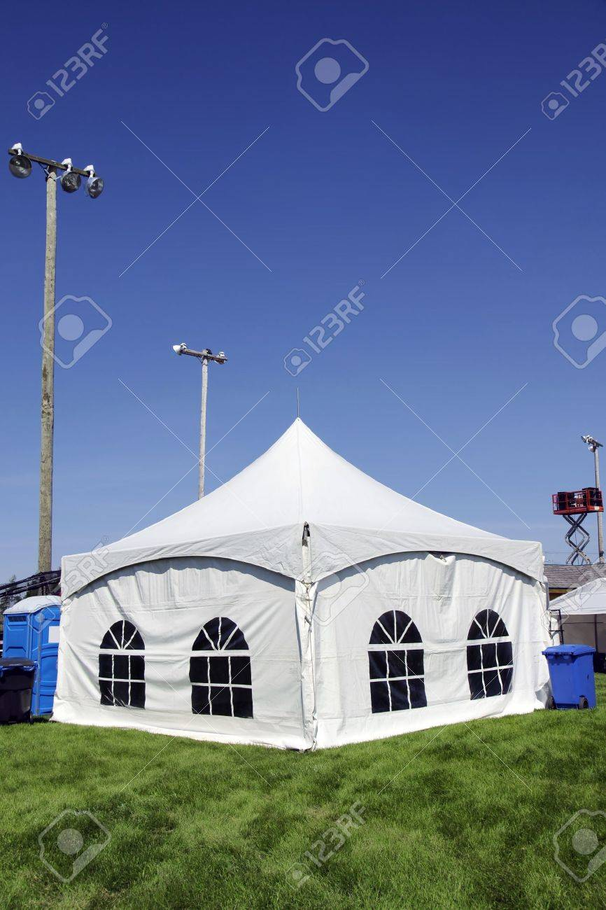 Celebration or event White tent on soccer field with lighting ready for guests in case & Celebration Or Event: White Tent On Soccer Field With Lighting ...