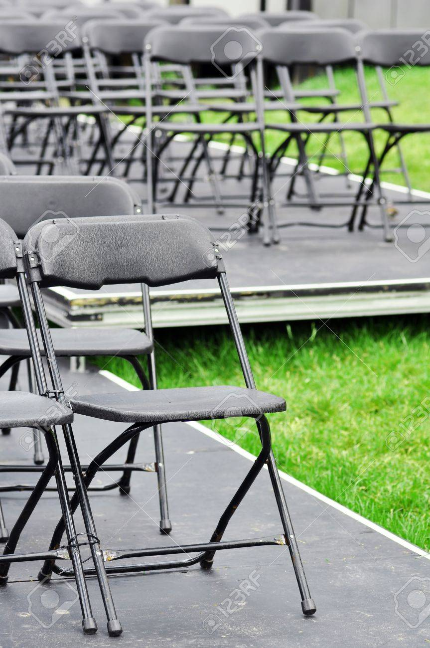 Empty outdoor concert stage - Rows Of Empty Plastic Folding Chairs On A Stage Outdoor In A Park Ready For The