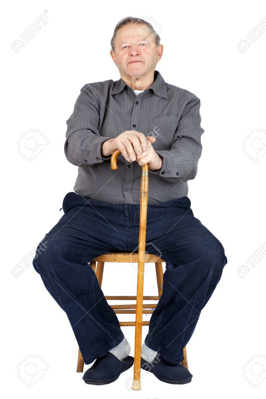 Senior Or Old Man Sitting Down On Old Wooden Chair With His Cane ...