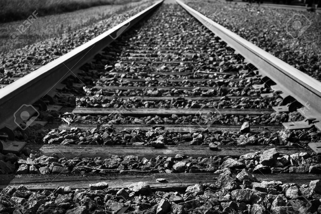 Dramatic black and white rendering of train tracks with diminishing perspective, great background. Stock Photo - 13108971