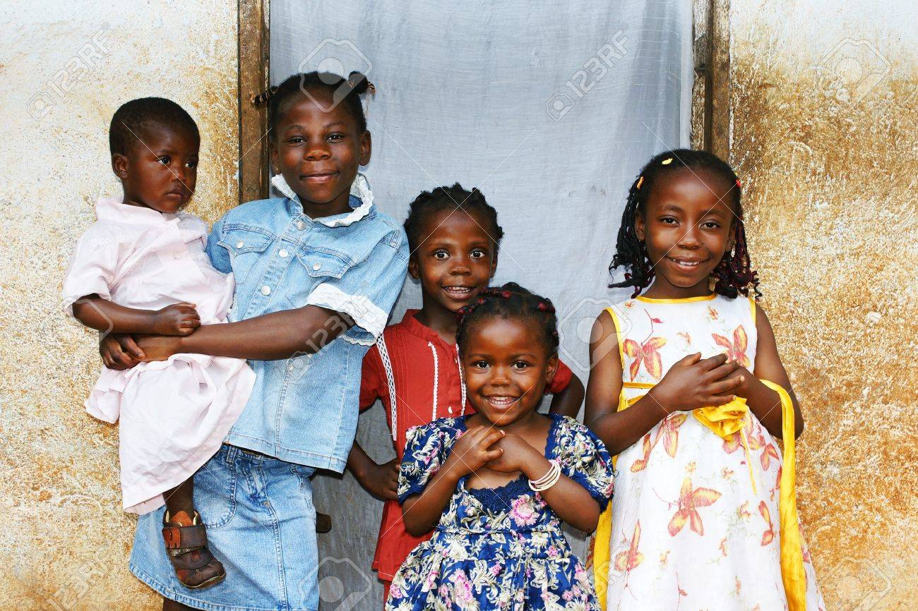 real candid family photo of five cute and sweet black african