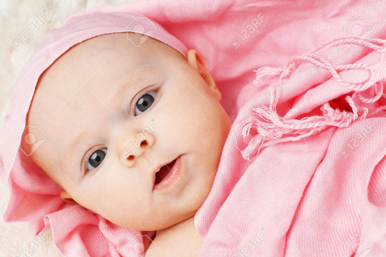 f32304cfb44a Portrait Of Beautiful 3 Months Old Baby Girl Draped In Pink Scarf ...