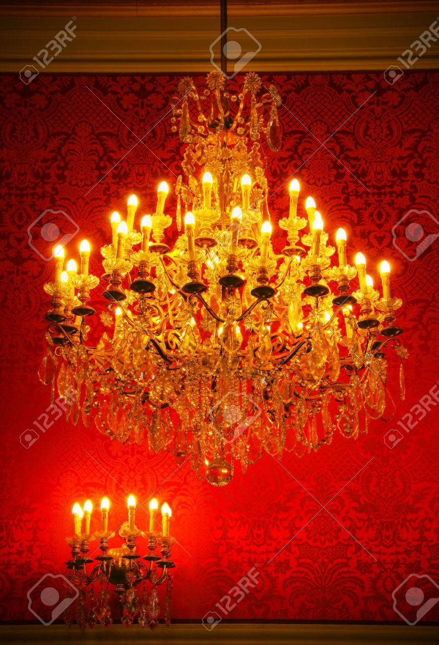 Real lavish crystal chandelier of French castle with tapestry and gold trim Stock Photo - 23457726