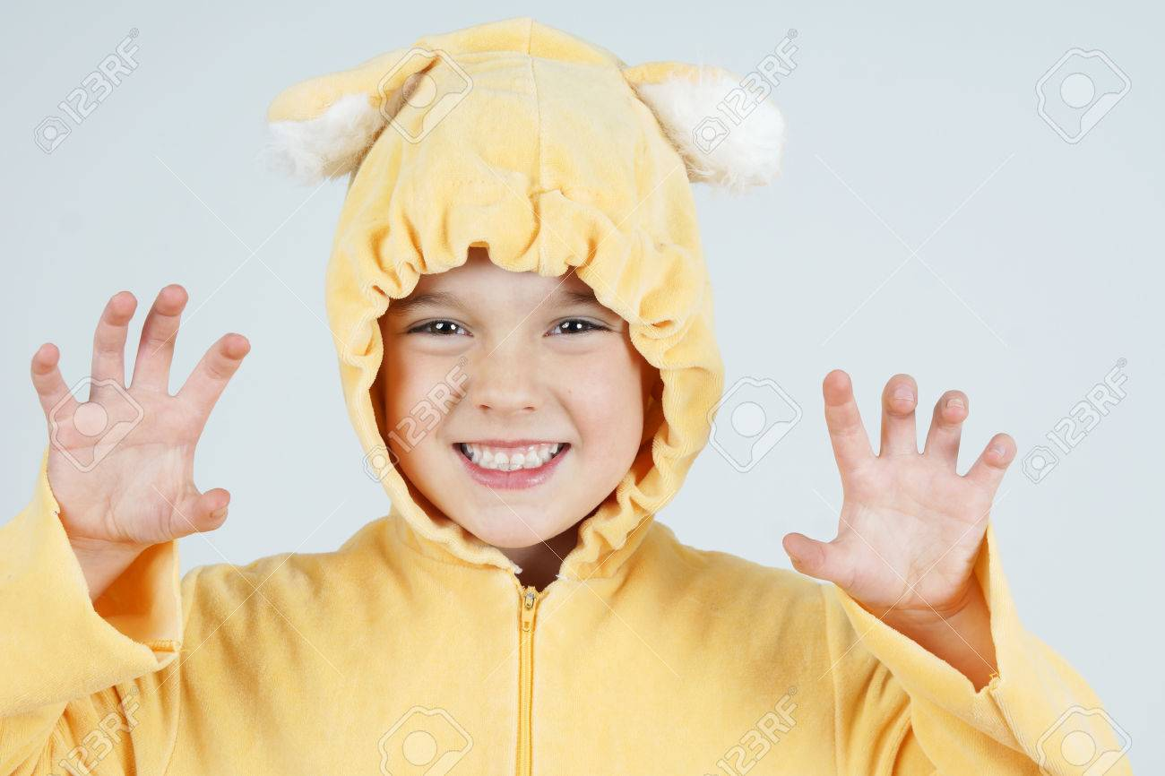 Cute Little Girl In Teddy Bear Costume Making Scary Face Stock Photo