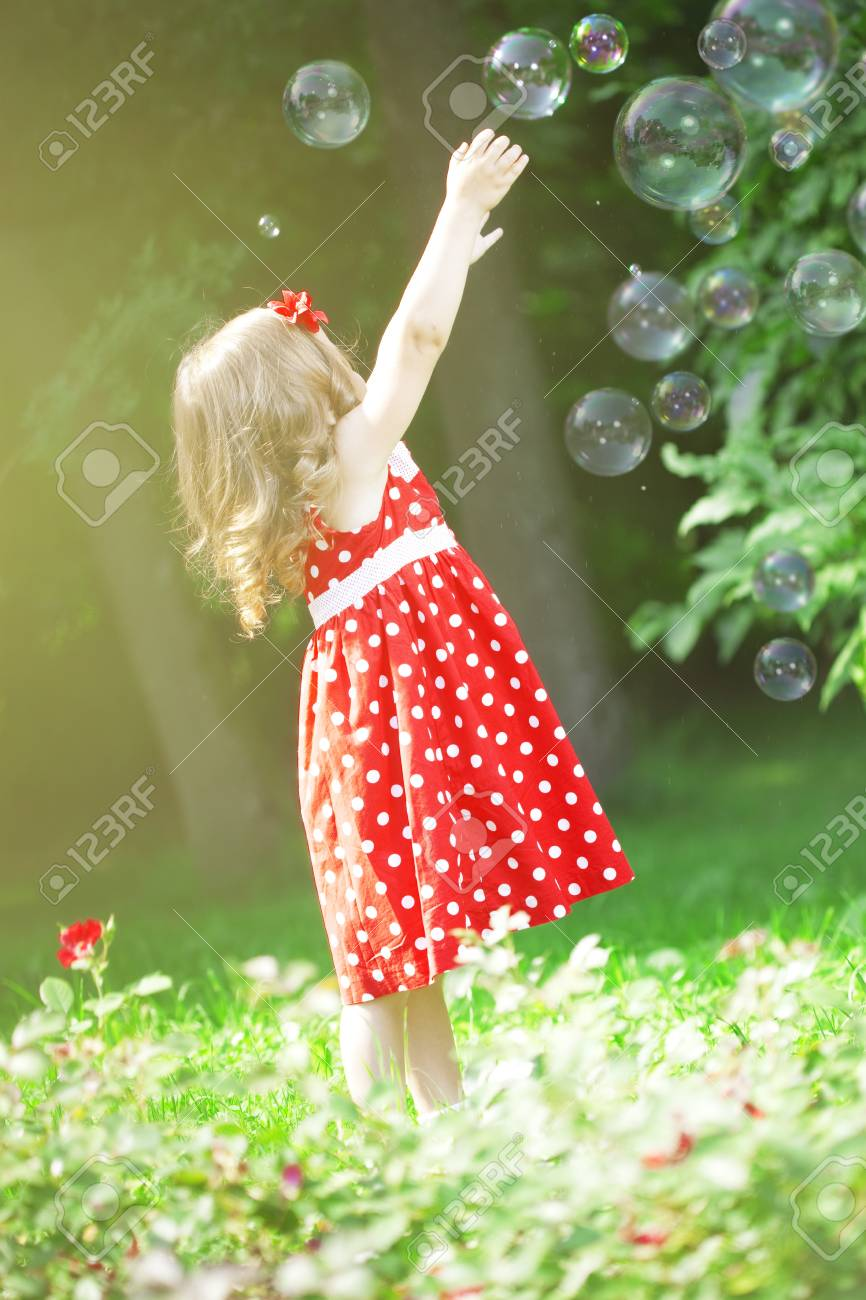 The image of a cute little girl with bubbles Stock Photo - 7624126