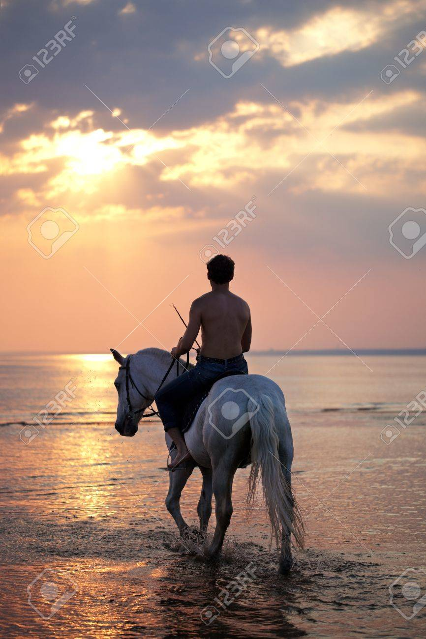 The image of a male riding a horse on the background of the sea Stock Photo - 10705370