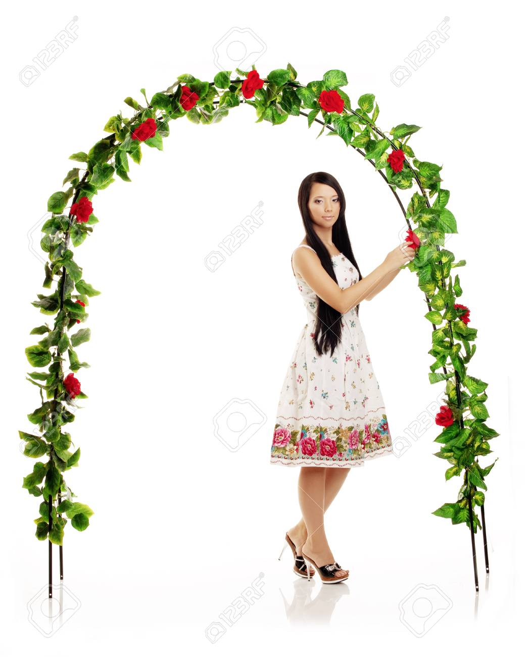 Picture of cute girl on the background of the arch entwined by roses Stock Photo - 10704961
