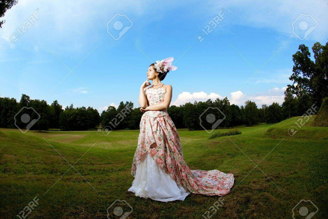A woman like a princess in an vintage dress in nature Stock Photo - 11527546