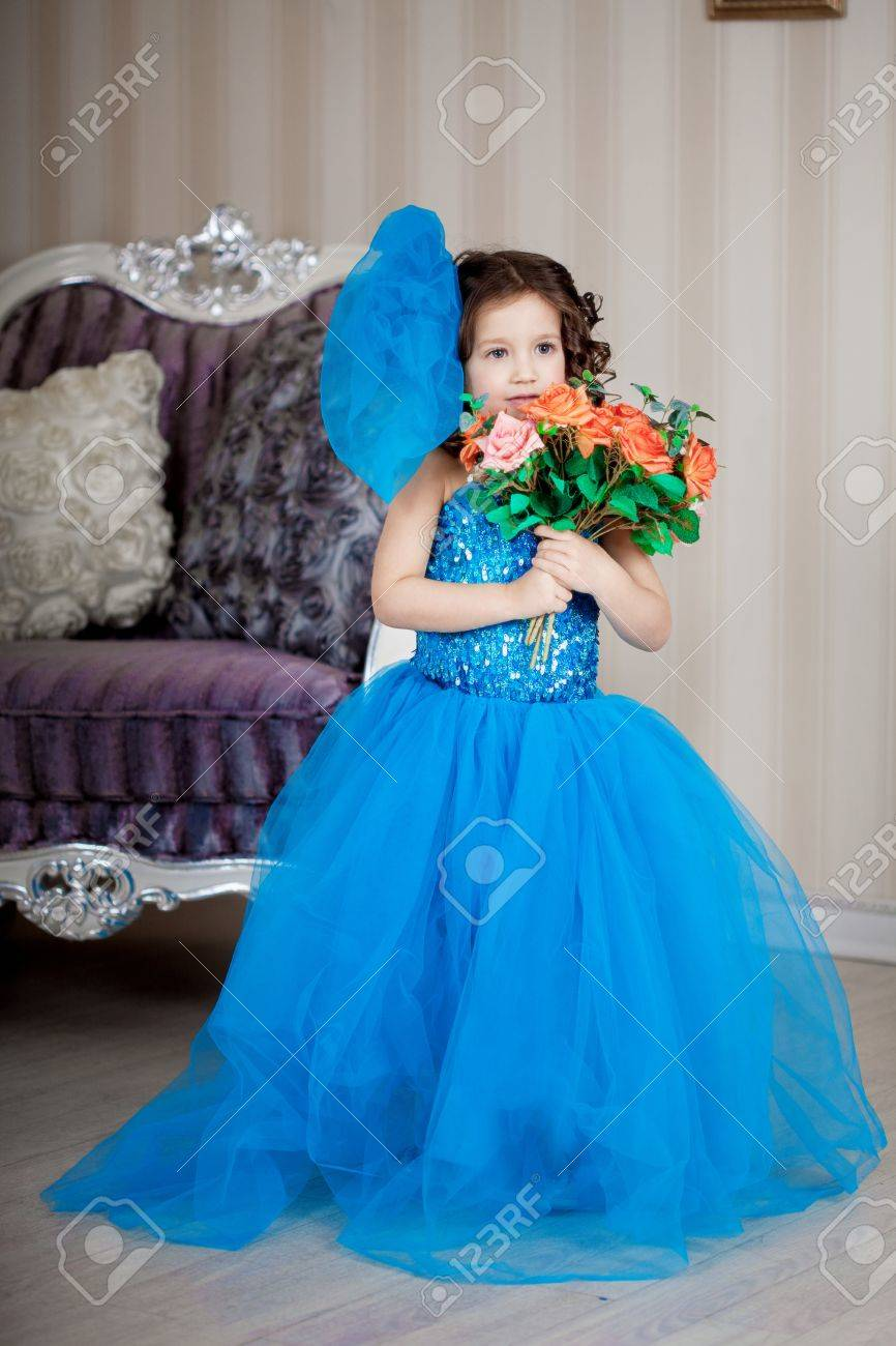 �ute little girl, a child in a gorgeous dress in the room Stock Photo - 14551870