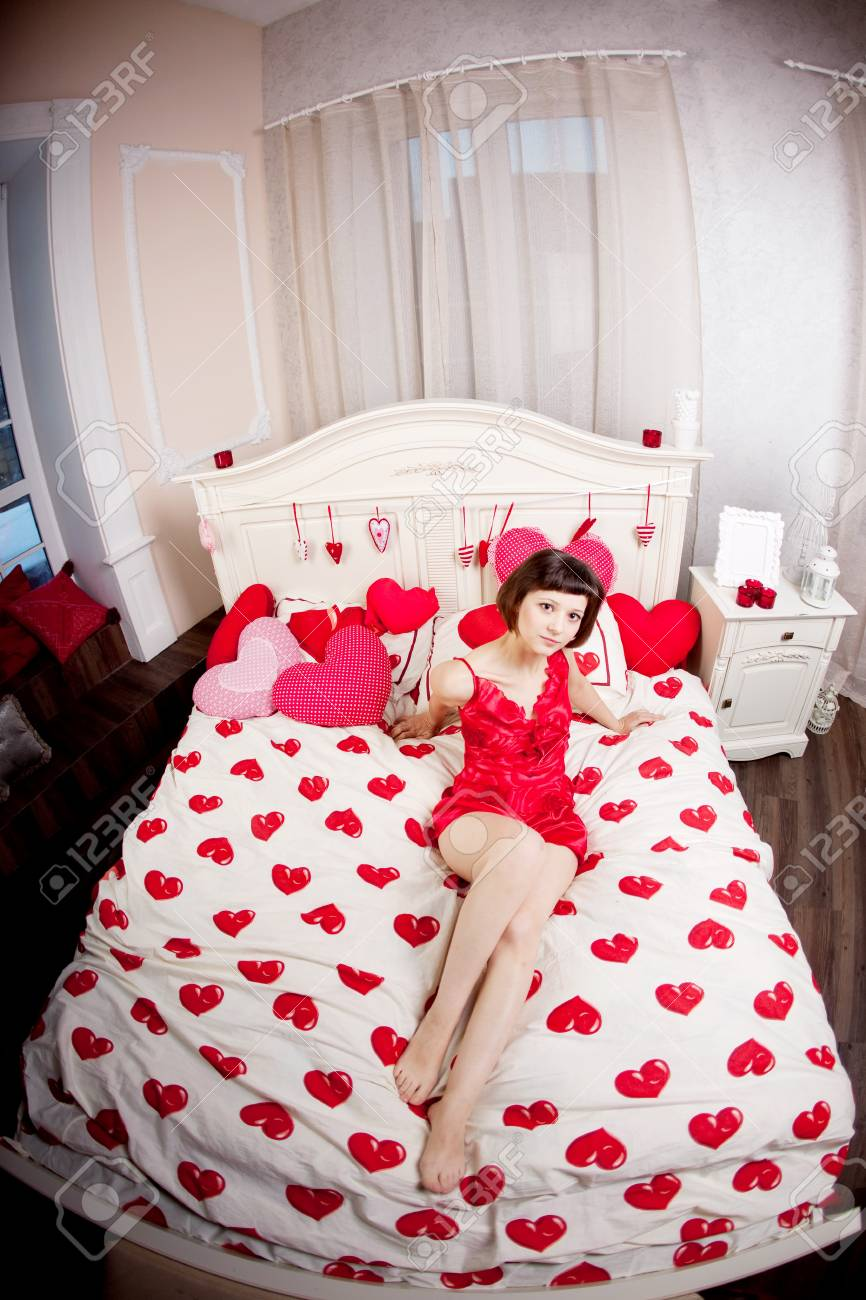 Beautiful woman in bed with hearts Stock Photo - 14723190
