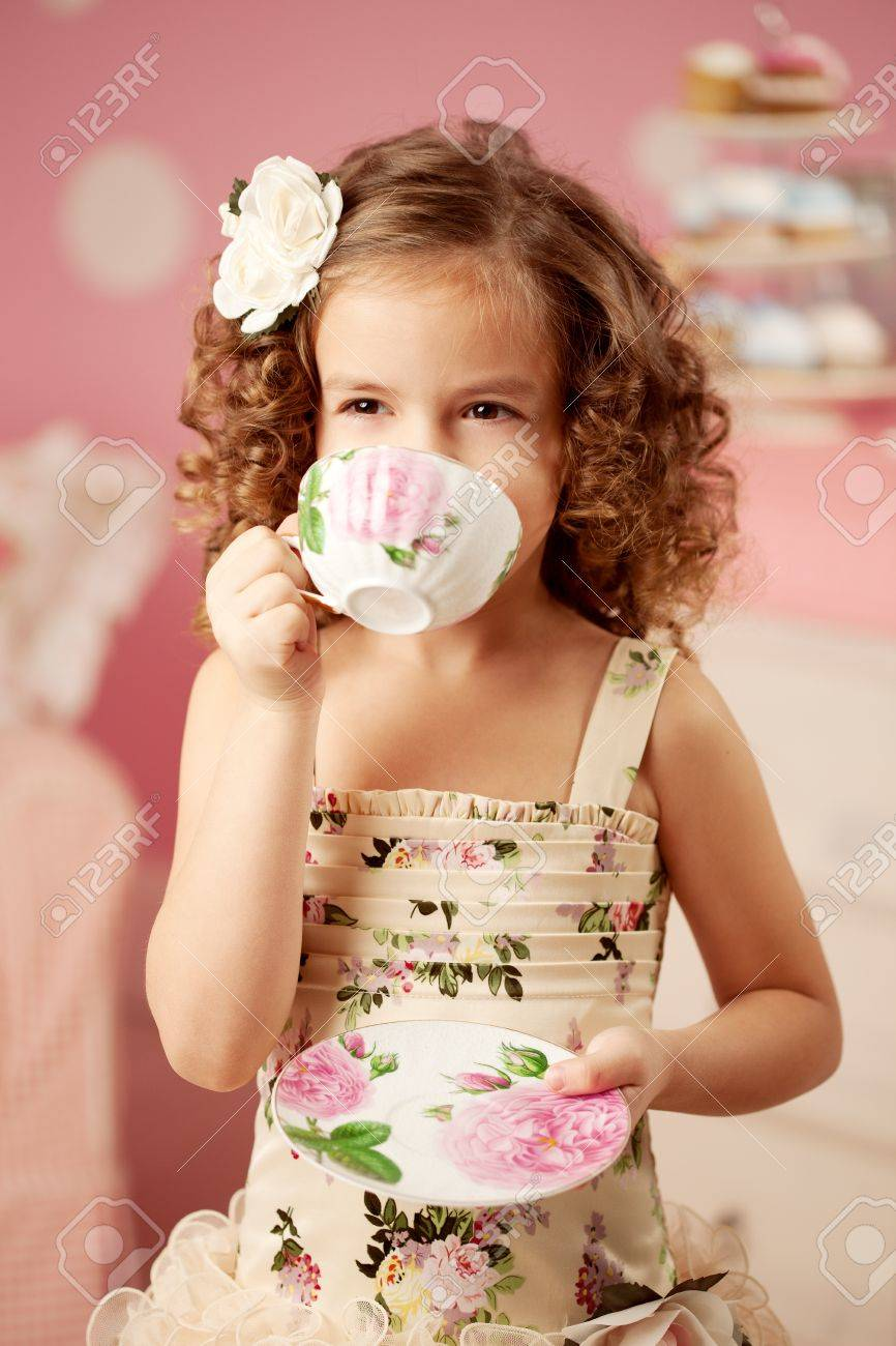 little cute and sweet girl with tea stock photo, picture and royalty