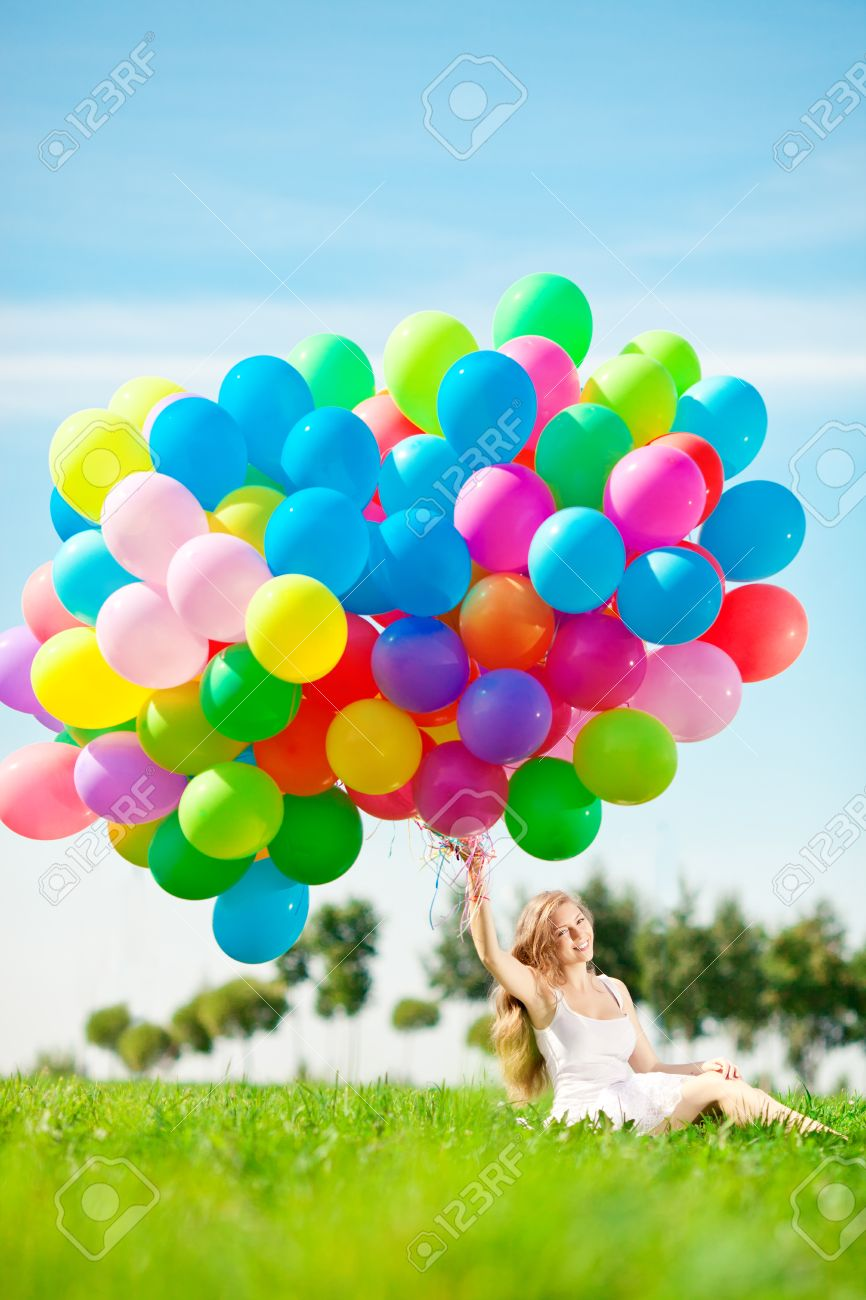 Happy Birthday Woman Against The Sky With Rainbow Colored Air Balloons In Hands Sunny And