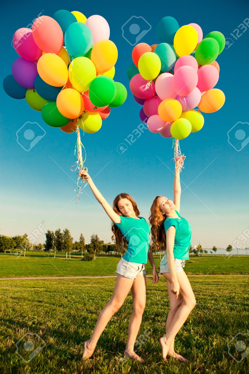 Happy Birthday Women Against The Sky With Rainbow Colored Air Balloons In Her Hands
