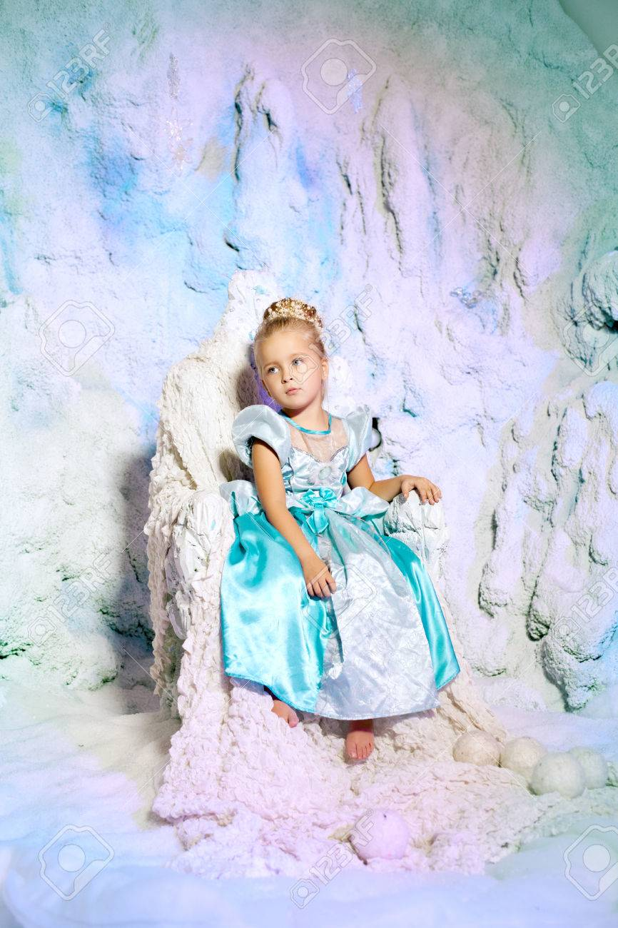 e90b1524b34e9 Little girl in princess dress on a background of a winter fairy tale. Baby  snow