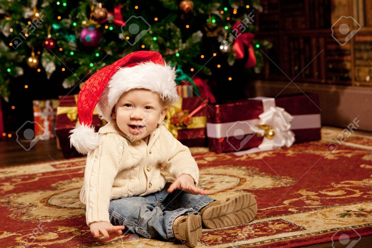 Nice Baby Near The Christmas Tree. Little Boy Celebrating ...