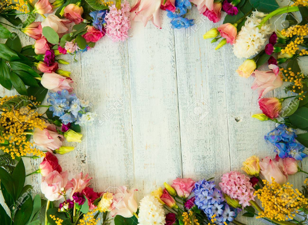 Spring flowers on wood background. Summer blooming border on a wooden table. - 72590180