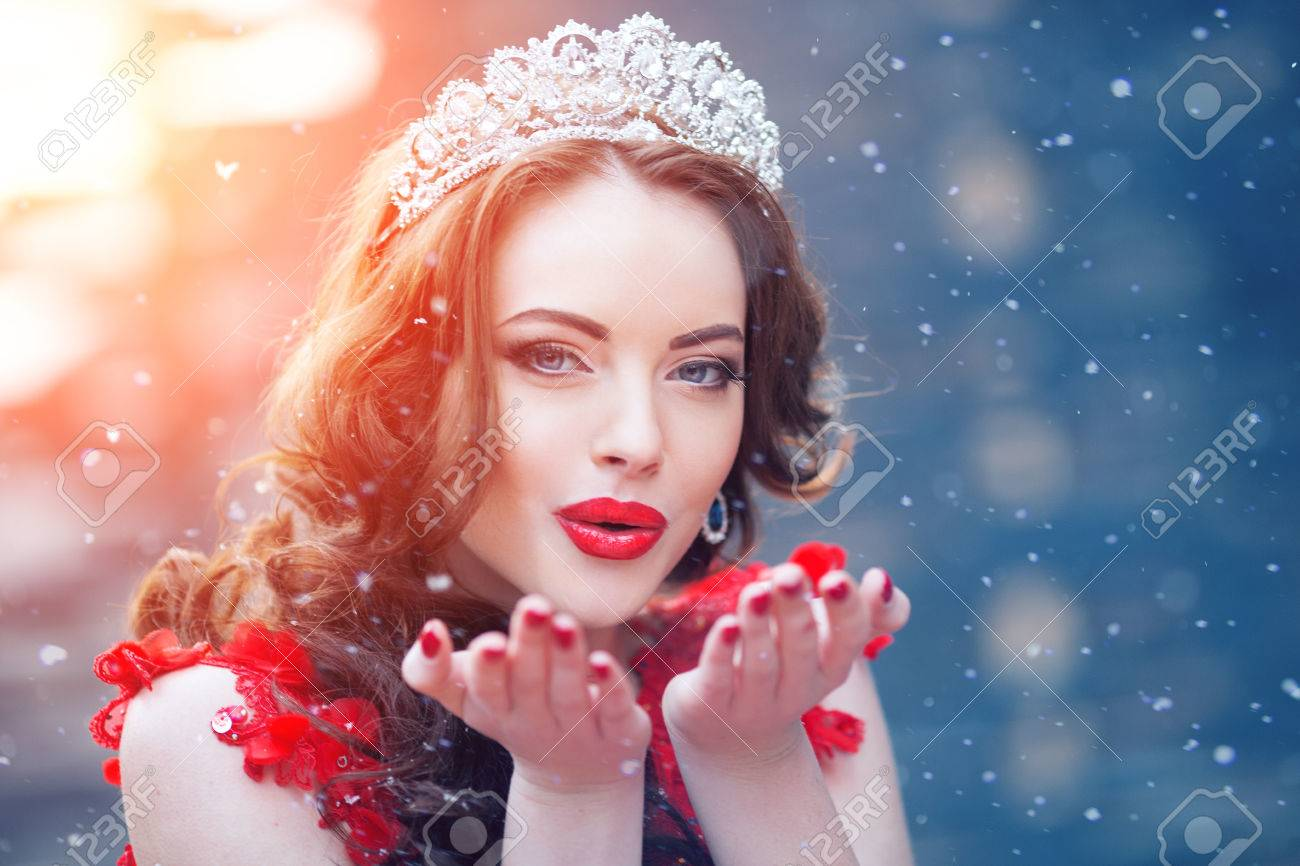 Snow Queen In Red Winter Woman Crown A Dress And Flakes Lipstick