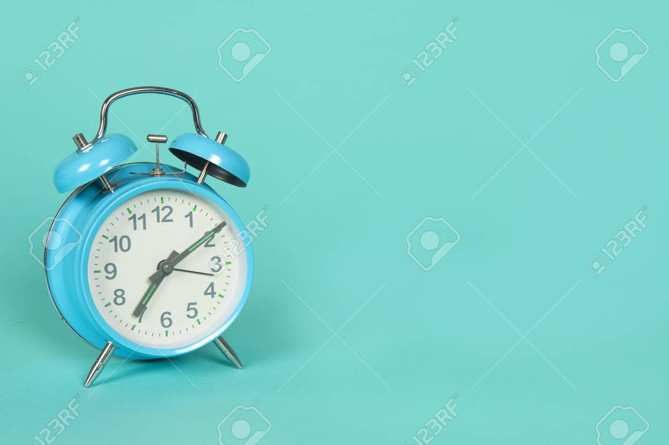 Blue retro clock on a blue background with copy space - 123558662