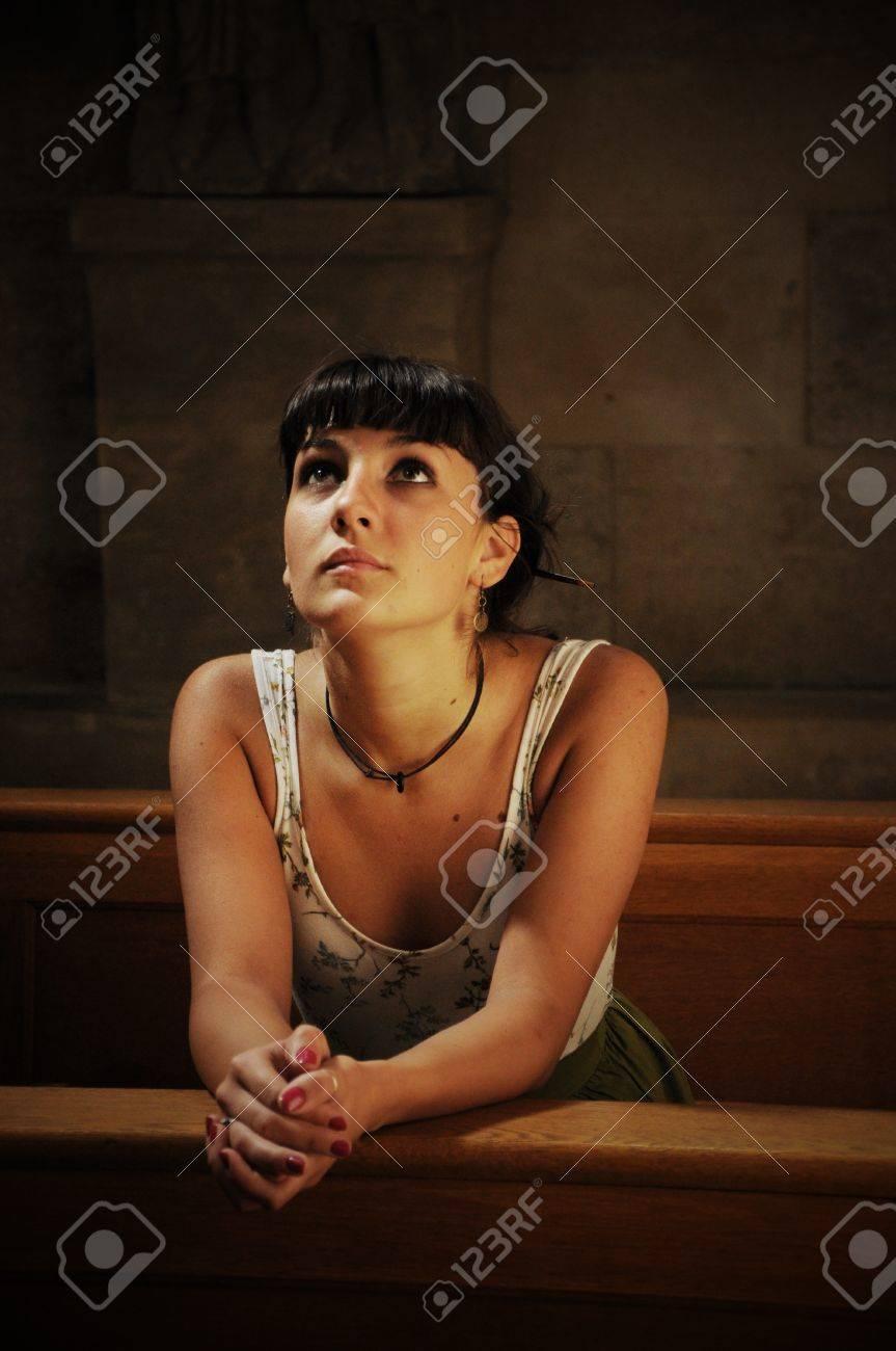 Teen girl praying in the church - 13354929