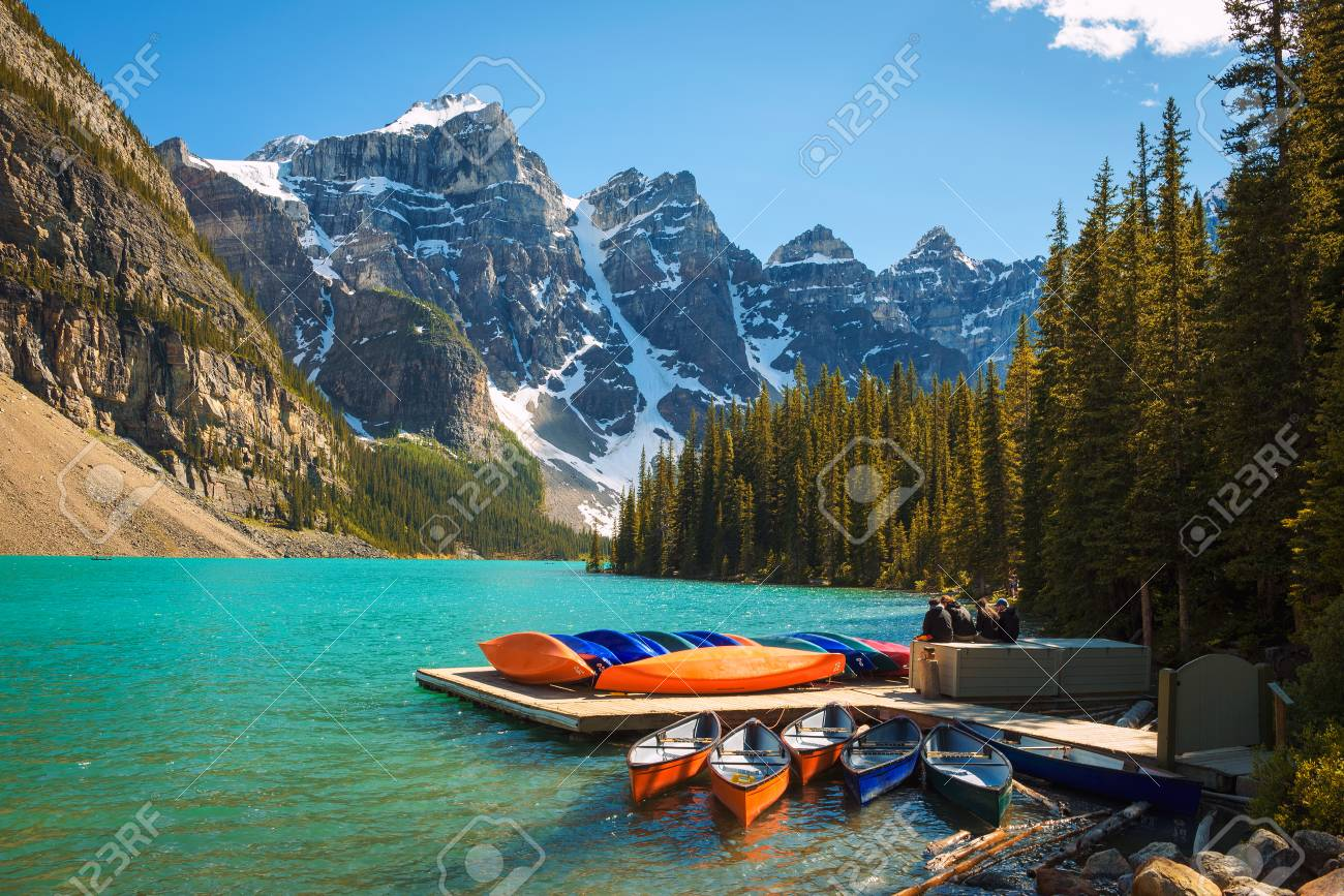 Canoes On A Jetty At Moraine Lake In Banff National Park Alberta
