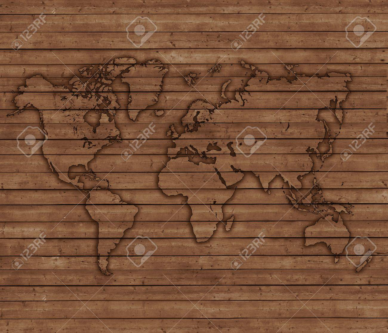 world map depicted on wooden boards wooden background