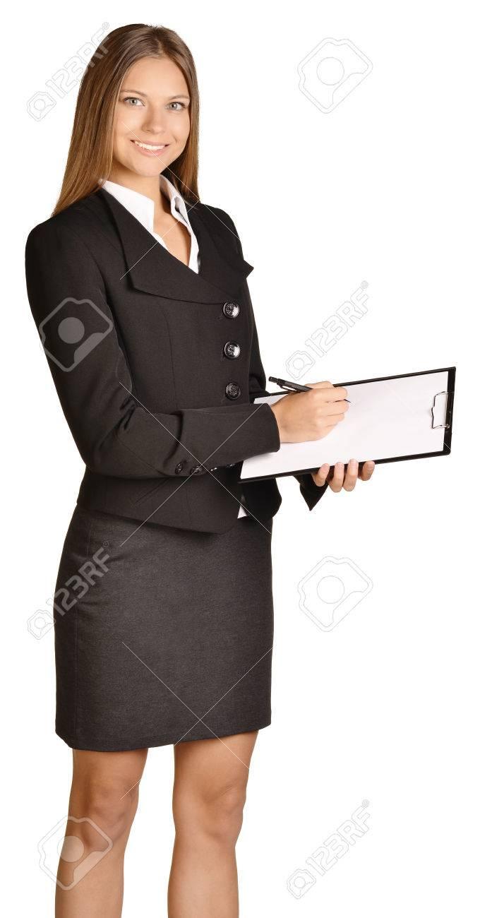 Business woman writes ballpoint pen on a clipboard - 35175873