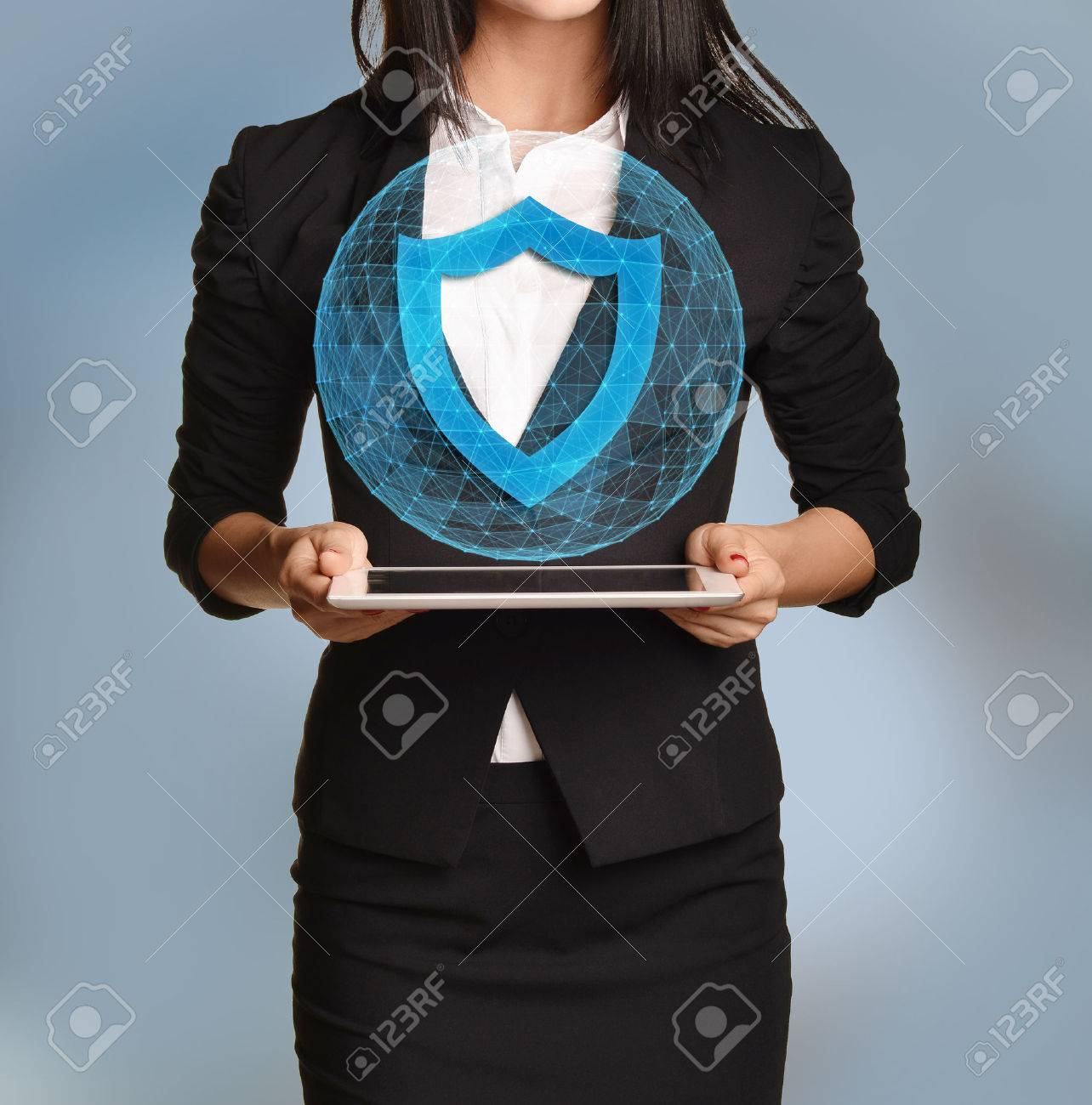 Beautiful girl holding a tablet with digital network globe and shield icon. - 47964254