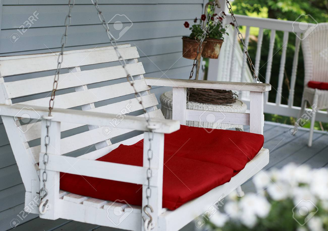 Old White Porch Swing With Red Cushions Stock Photo Picture And