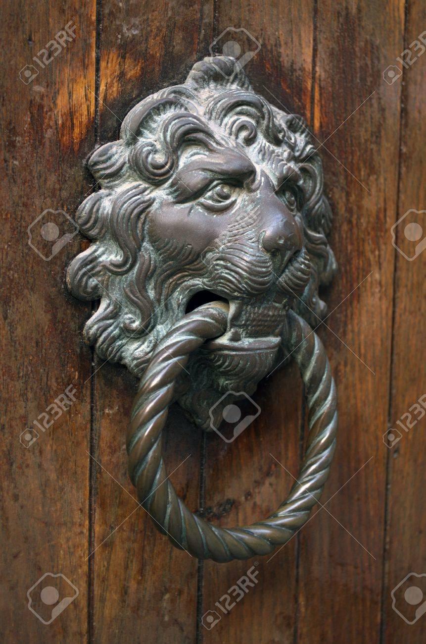 Stock Photo   Traditional Venetian Gilded Lion Head Door Knob In Venice On  The Wooden Door