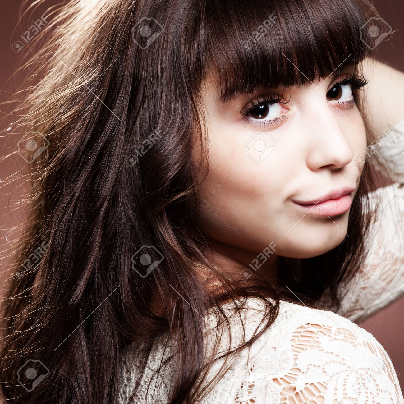 A Pretty Girl With Chocolate Hair Over Brown Stock Photo, Picture ...