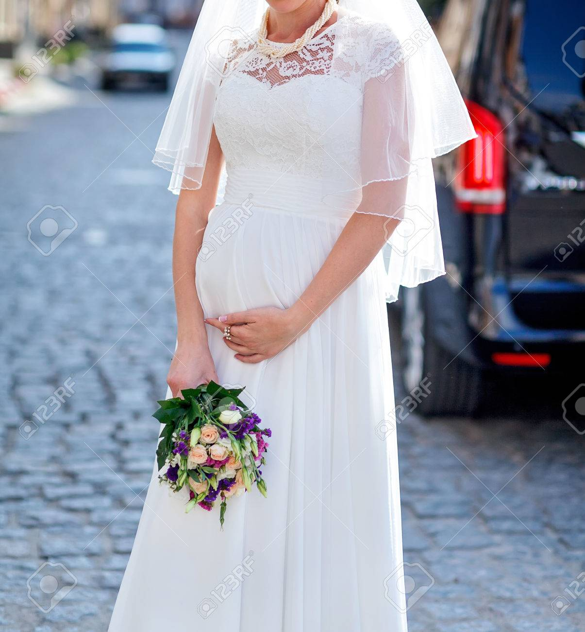 Pregnant Bride In A Wedding Gown Holding Belly With Hands Stock ...