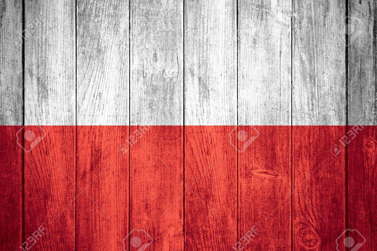 flag of poland or white and red polish banner on wooden background