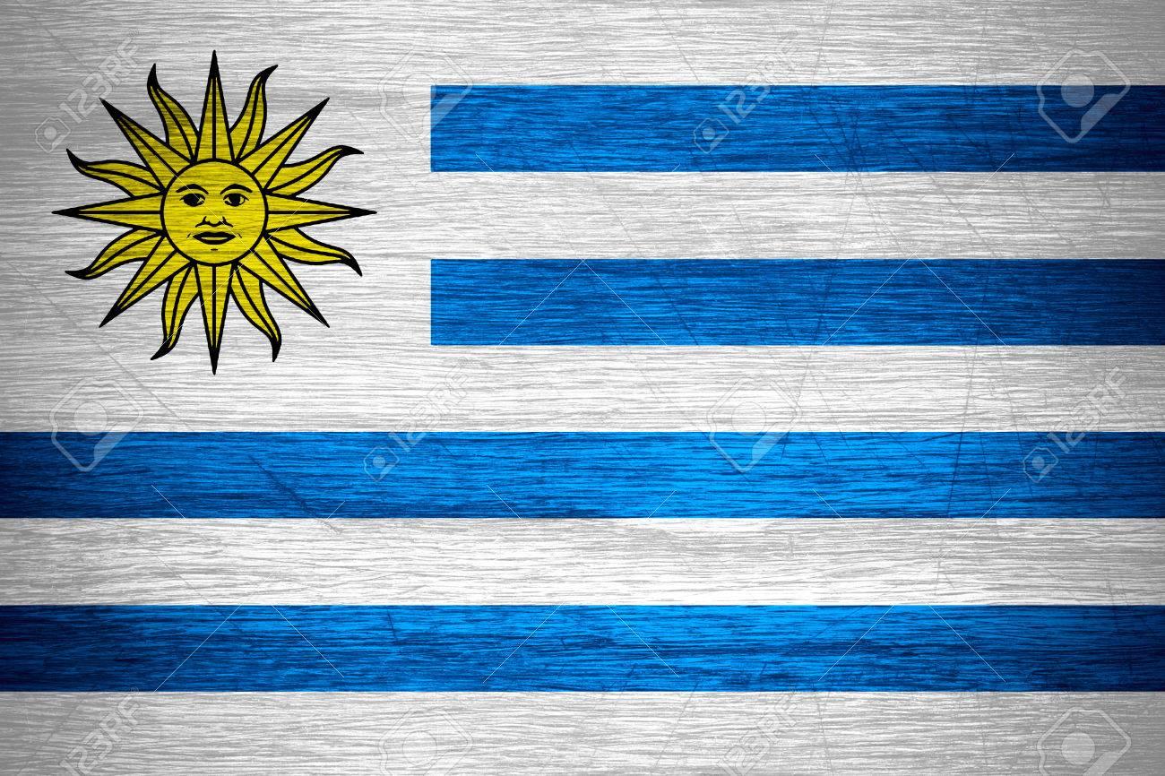 Uruguay Flag Or Uruguayan Banner On Wooden Texture Stock Photo - Uruguay flag