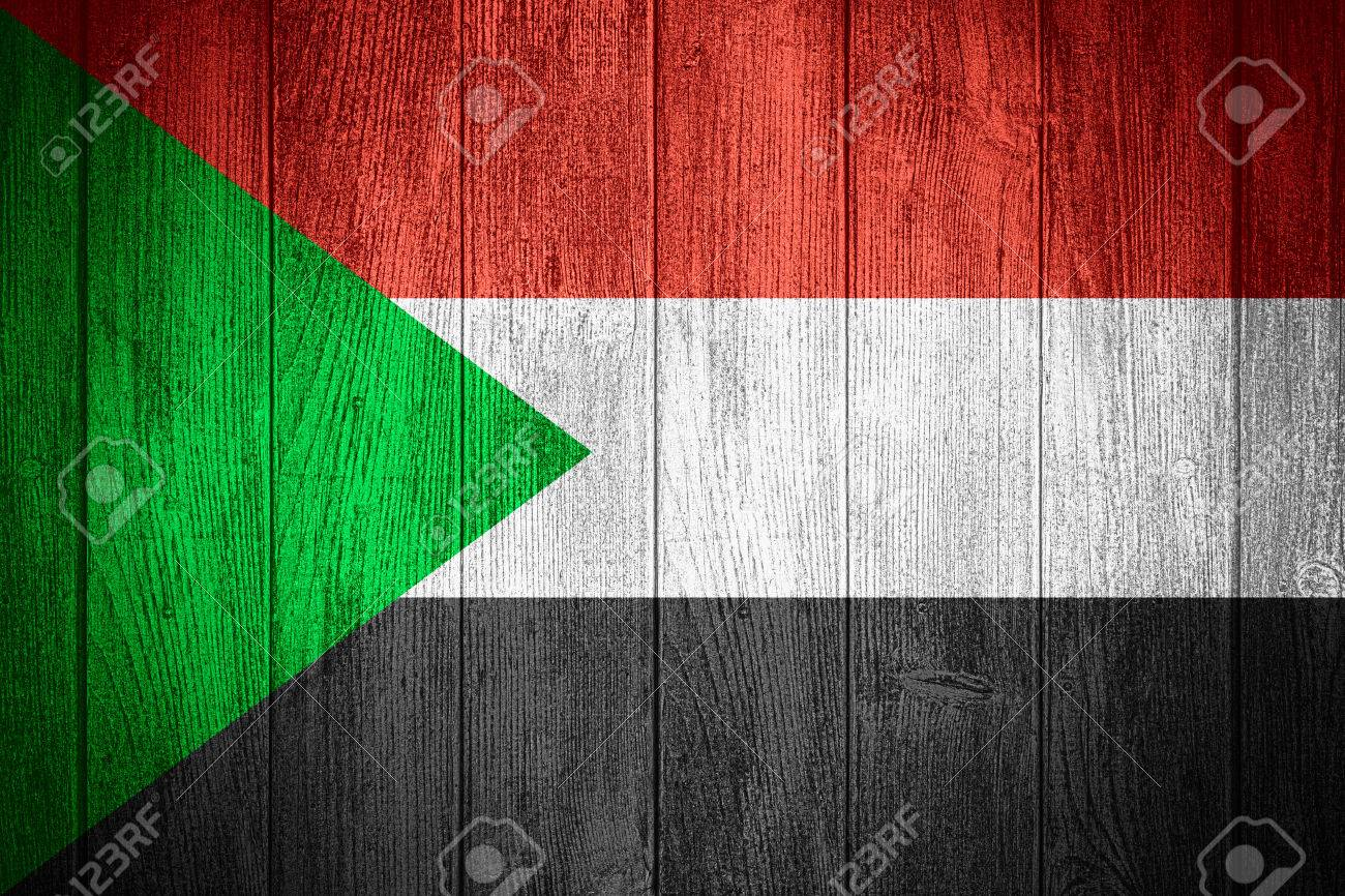 sudan flag or sudanese banner on wooden boards background stock