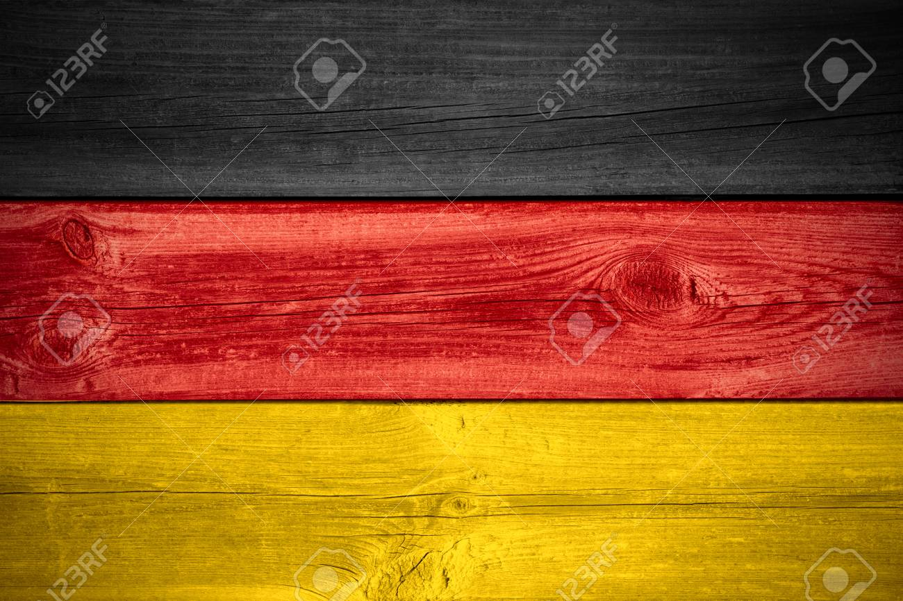 flag of germany or german banner on wooden background stock photo