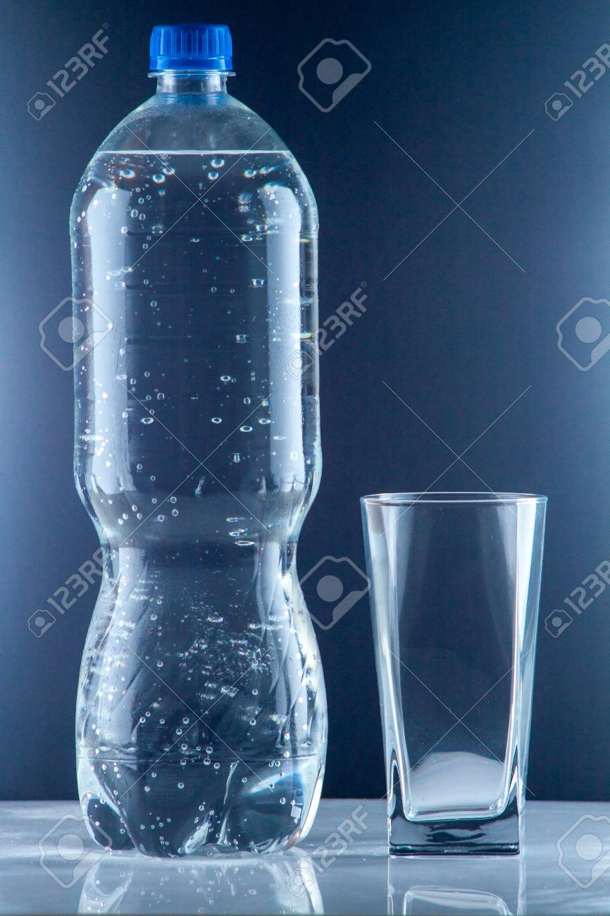 bottle of clear drinking cold mineral water with gas in isolation