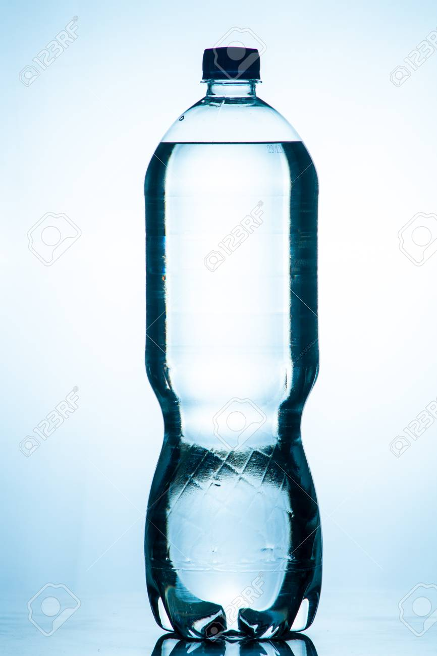 bottle of clear drinking cold mineral water with gas isolated