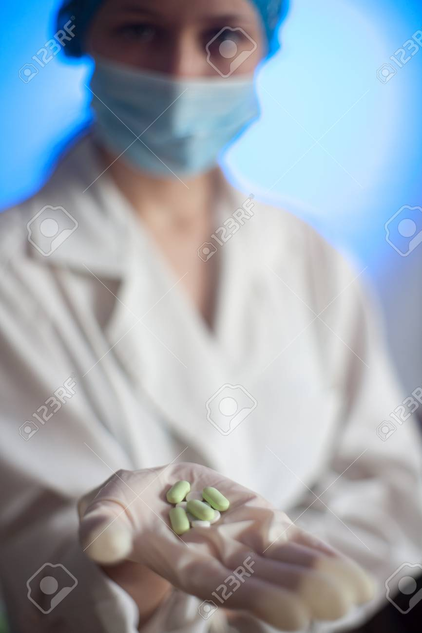 Strange A Nurse In A Hospital With Medication Tablets In His Hand For Home Interior And Landscaping Ologienasavecom