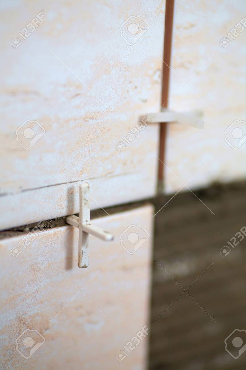 Laying Of Tiles Industrial Construction Worker Installing Small ...