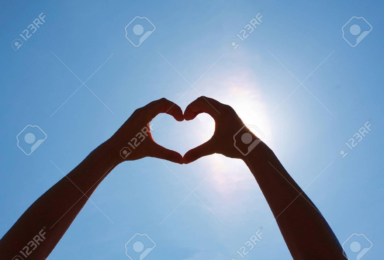 Girls heart hands on the sky - 41841731