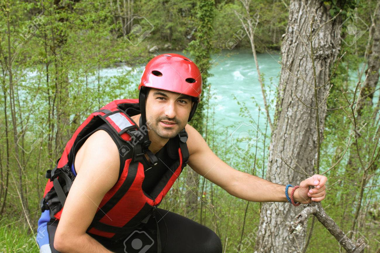 Adult man Wearing Water sport and rafting equipment - 49800548