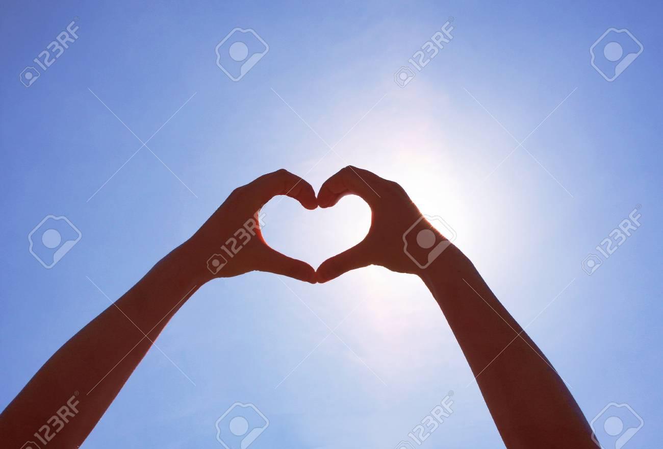 Girls heart hands on the sky - 50174688
