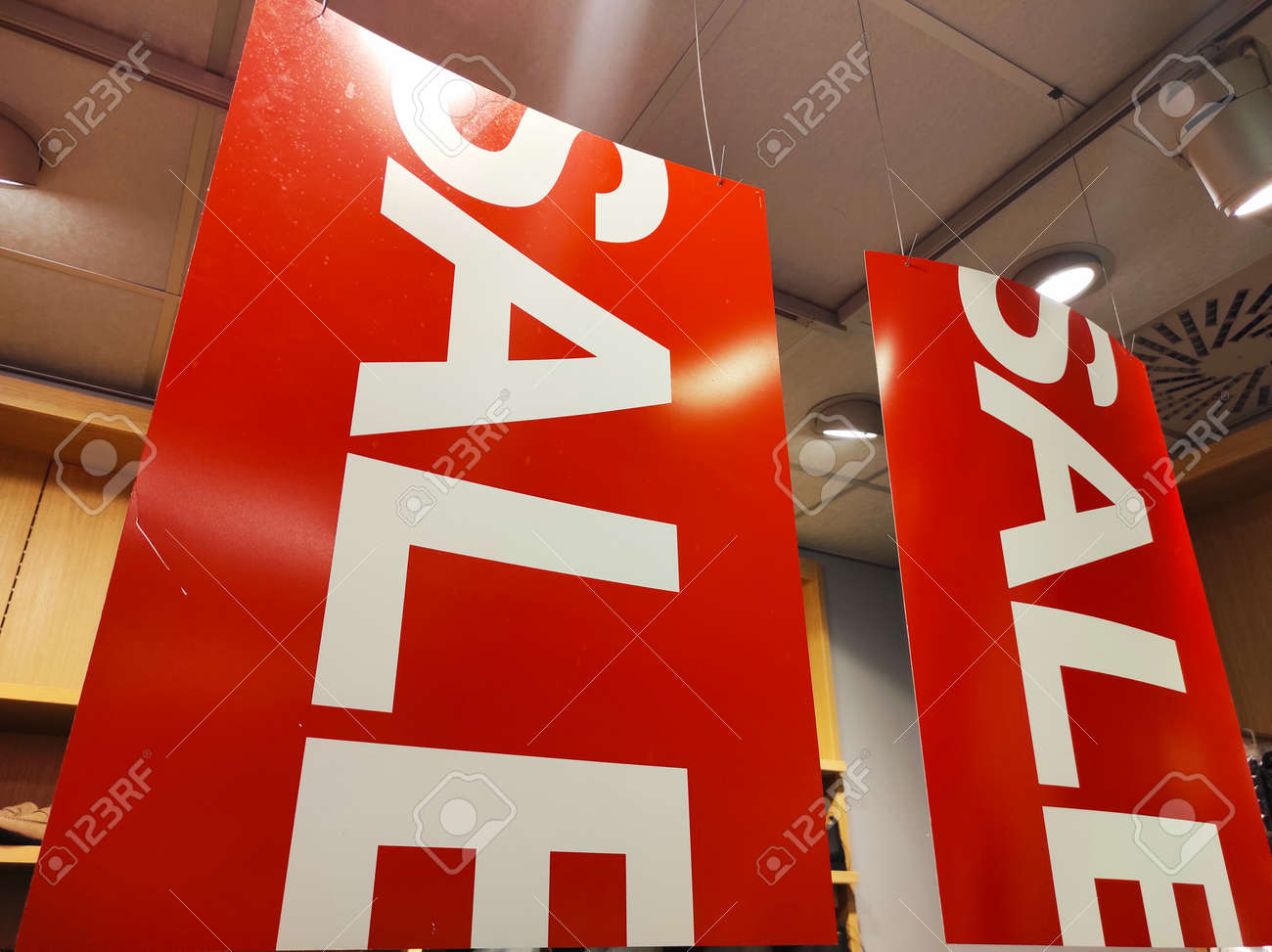 Sale signs in a clothing store. - 155645483