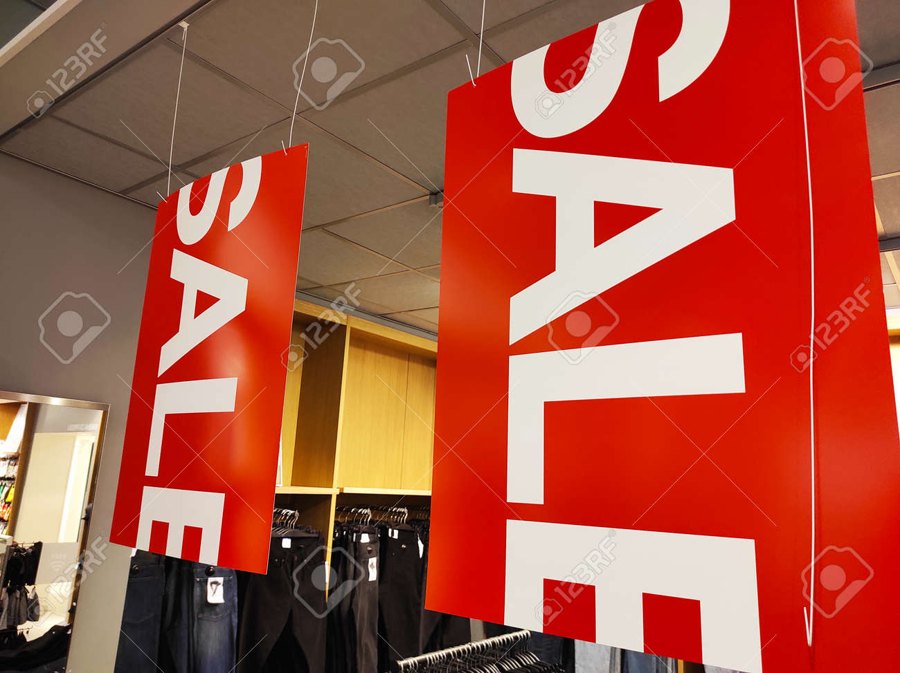 Sale signs in a clothing store. - 155803853